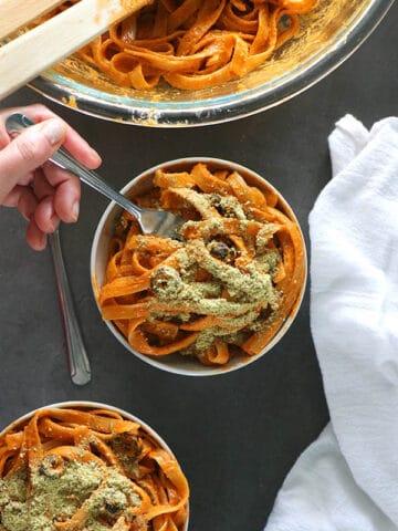 overhead photo of vegan red pepper pesto fettuccine