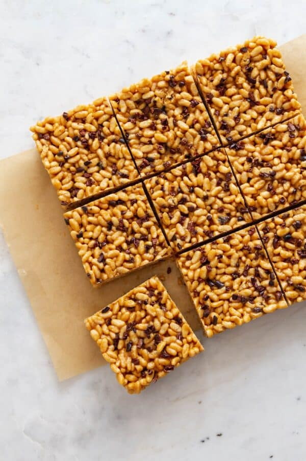 overhead photo of peanut butter rice crispy treats on a white marble tabletop