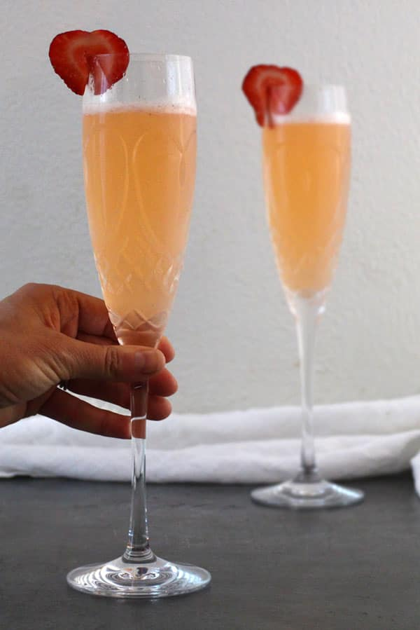 picking up a champagne flute