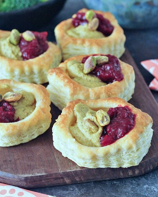 close-up of vegan thanksgiving tarts on a wooden cutting board