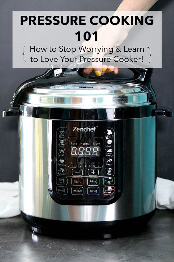 hand opening an electric pressure cooker lid