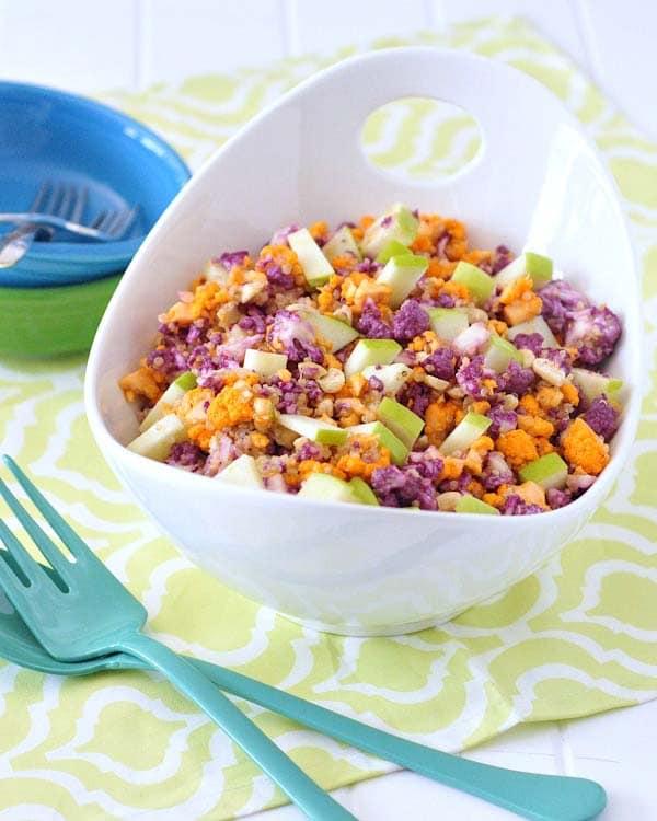 bowl of colorful vegan salad on a yellow napkin