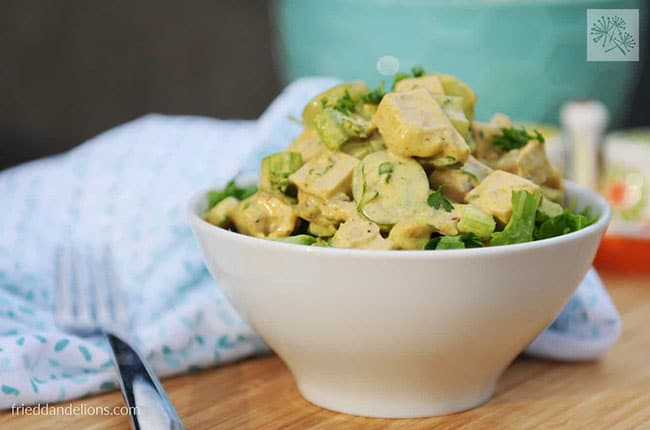 white bowl of vegan chicken salad on a wooden tabletop