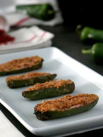 serving platter of vegan stuffed jalapeno poppers