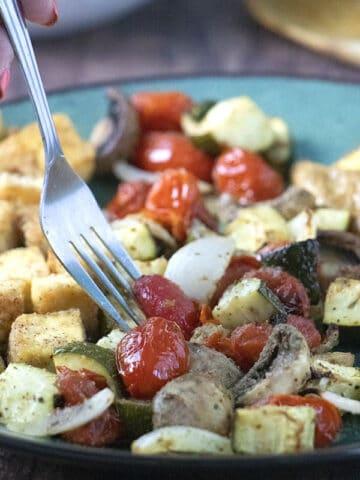 fork taking a bite of air fryer vegetables
