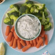 serving platter with vegan ranch dip with carrots and broccoli for dipping