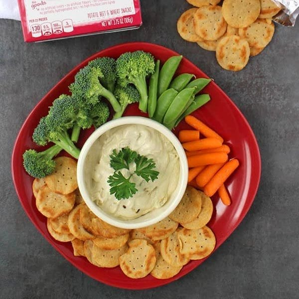 overhead photo of vegan french onion dip on a party platter