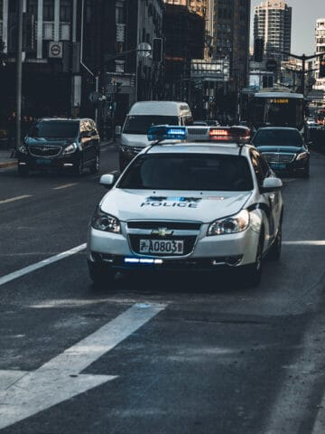 A police car driving down a busy city street