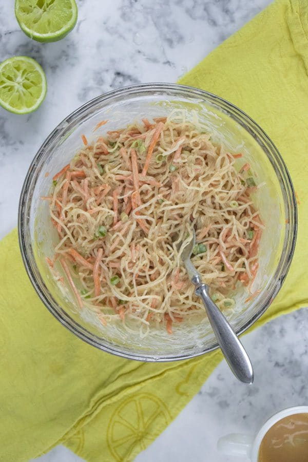 veggies and noodles mixed with peanut dressing