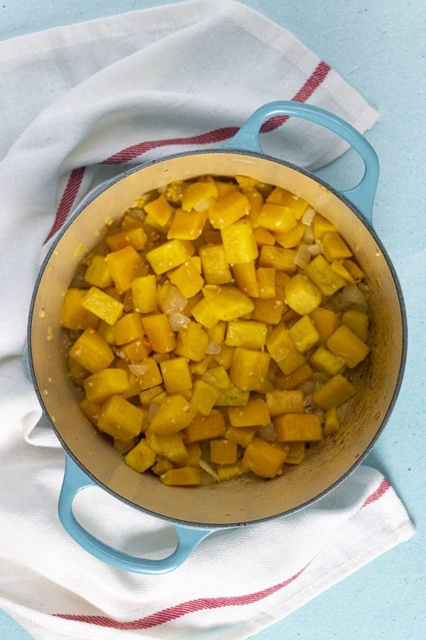 sauteed butternut squash with onions and garlic in a Dutch oven