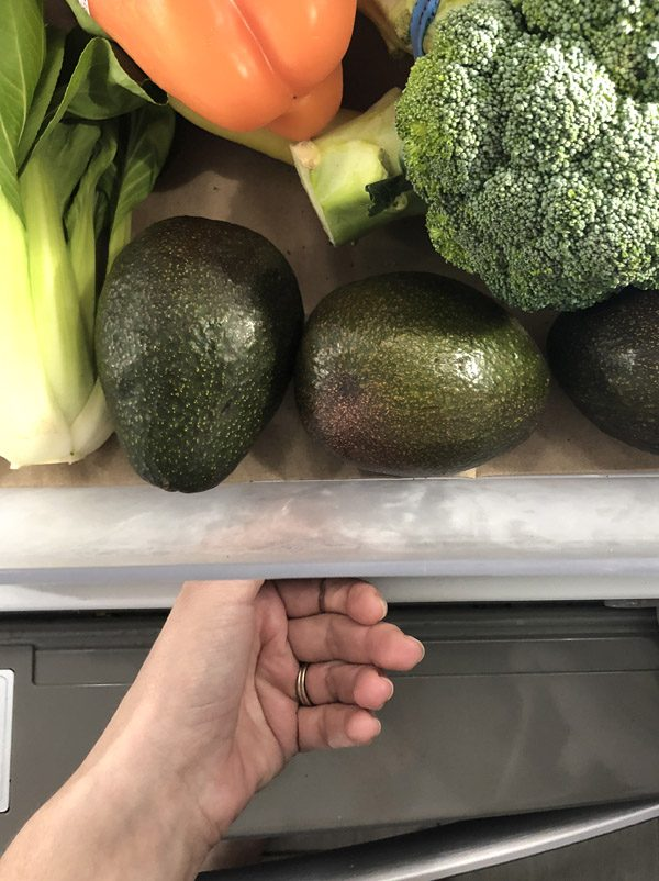 avocados stored in a produce drawer in the refrigerator