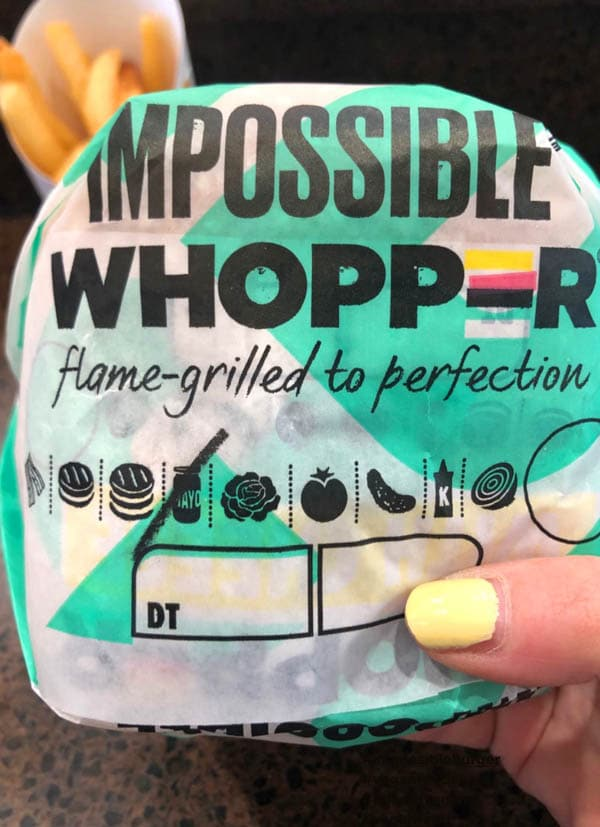 hand holding an Impossible Whopper