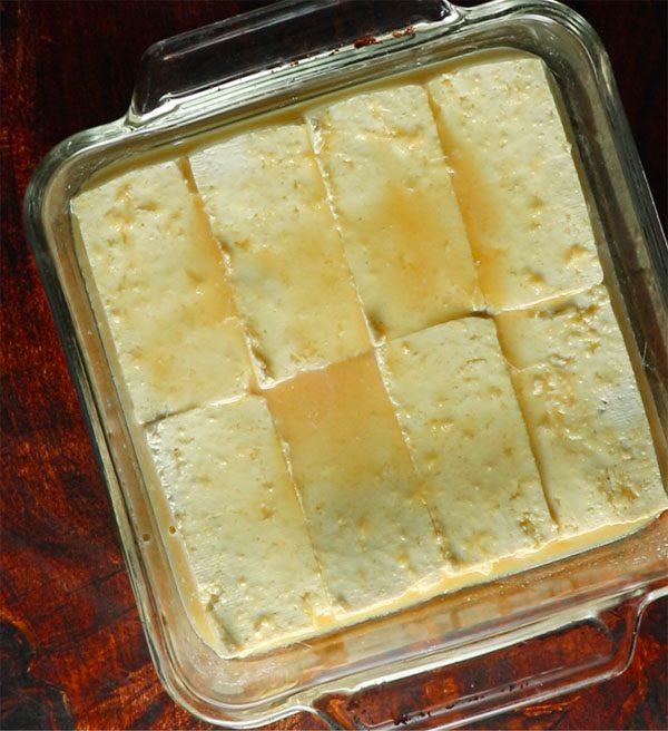 a glass baking pan, marinating tofu in orange-ginger marinade