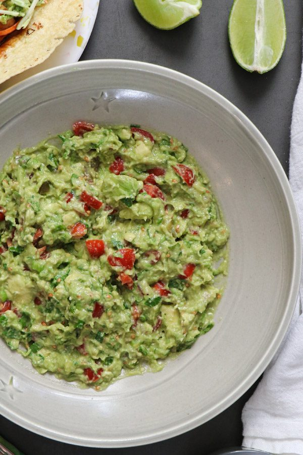 pickled jalapeno guacamole in a gray serving bowl