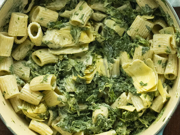 Dutch oven full of spinach artichoke pasta