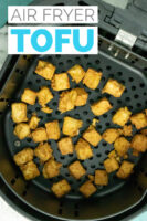 basket of air fryer tofu with a text overlay