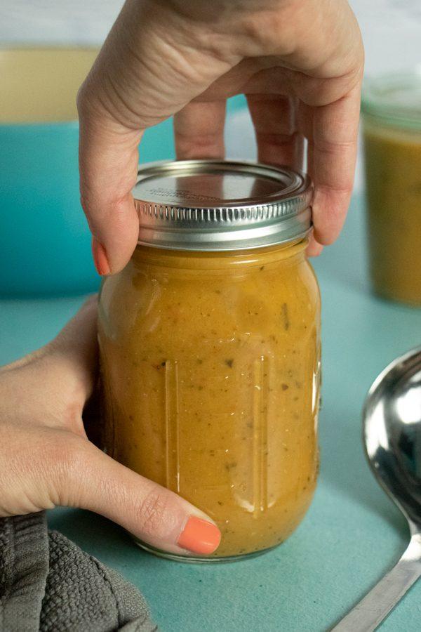 closing a jar of eggplant tomato soup