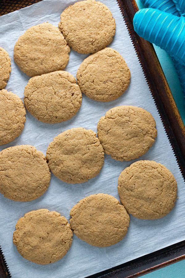 freshly baked vegan brown sugar cookies cooling on the baking sheet