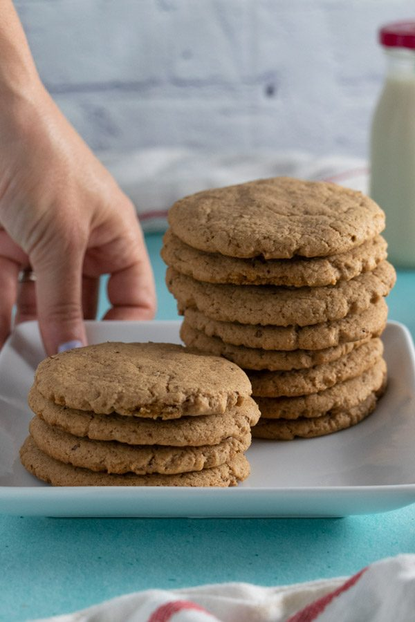 putting down a plate of vegan brown sugar cookies