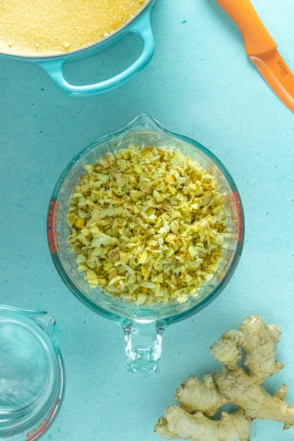 chopped ginger in a measuring cup