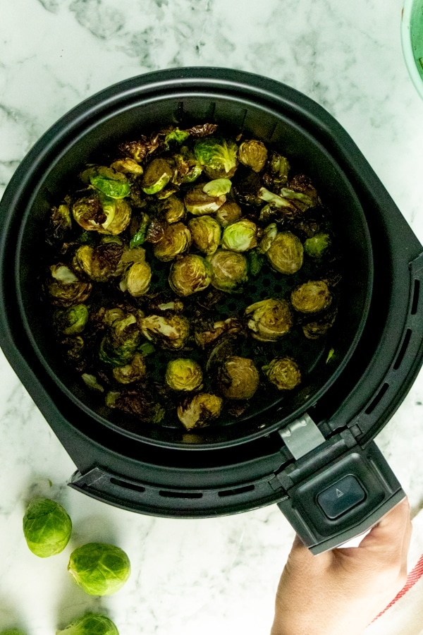 cooked brussels sprouts in the air fryer basket