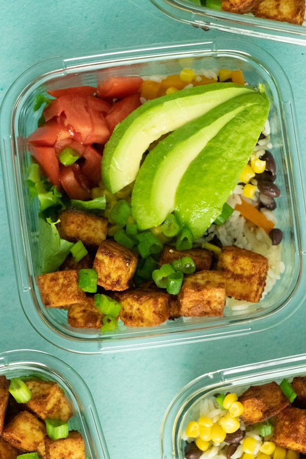 close-up of the tofu burrito bowl, so you can see the toppings: tomato, corn, avocado, green onions