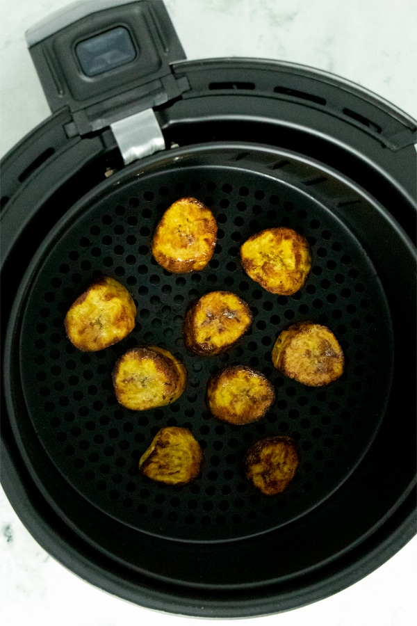 cooked plantains in an air fryer basket