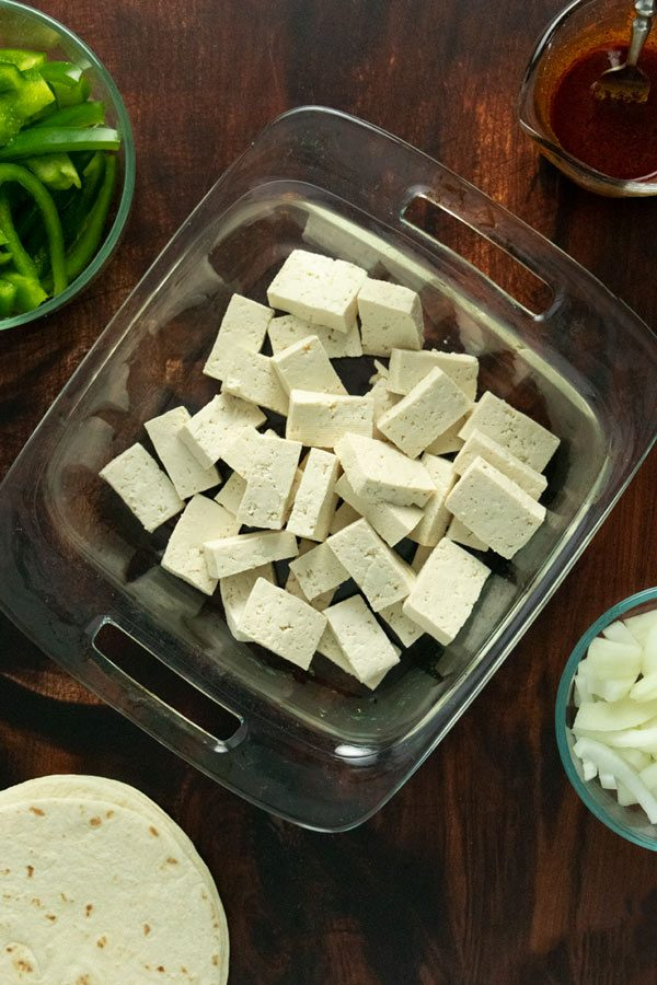 sliced tofu in a glass baking pan