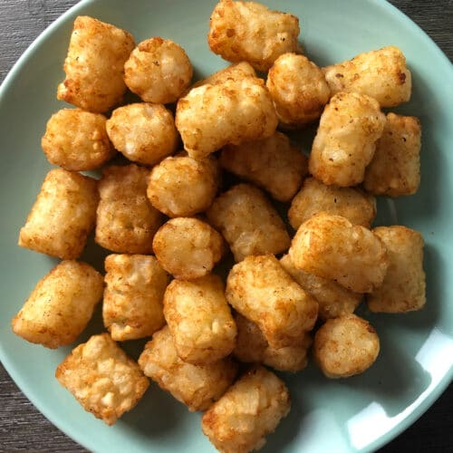 overhead photo of crispy tots on a blue plate