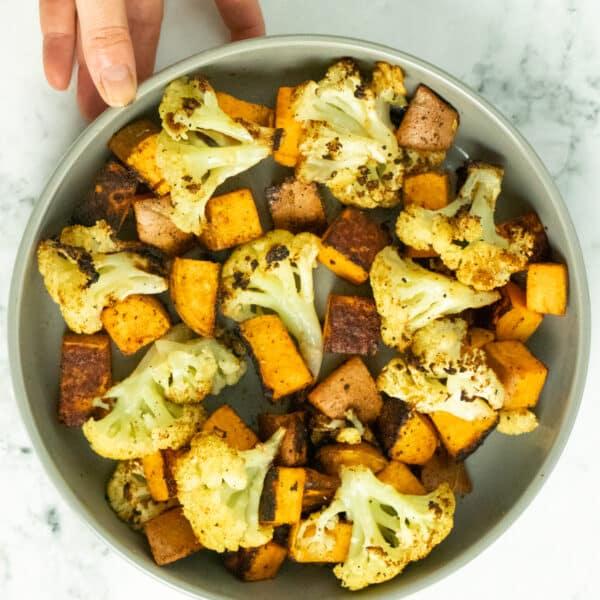 serving dish of roasted cauliflower and sweet potato