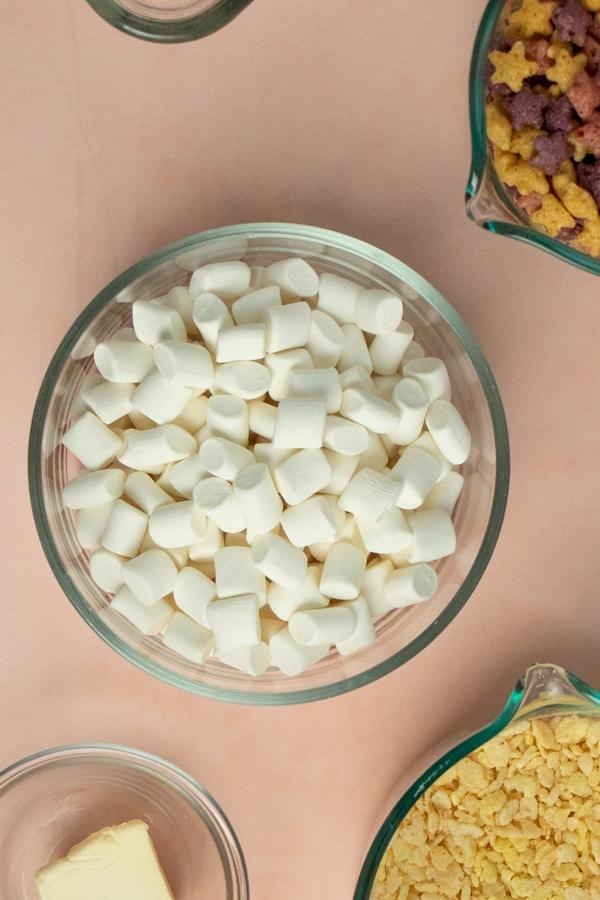 vegan rice krispie treats ingredients on a light pink tabletop