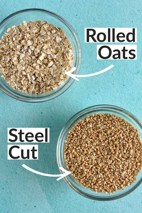 overhead photo of bowls of uncooked rolled oats and steel cut oats, with text overlay pointing out which is which