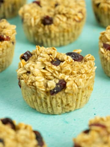 close-up of a baked oatmeal cup with dried cranberries