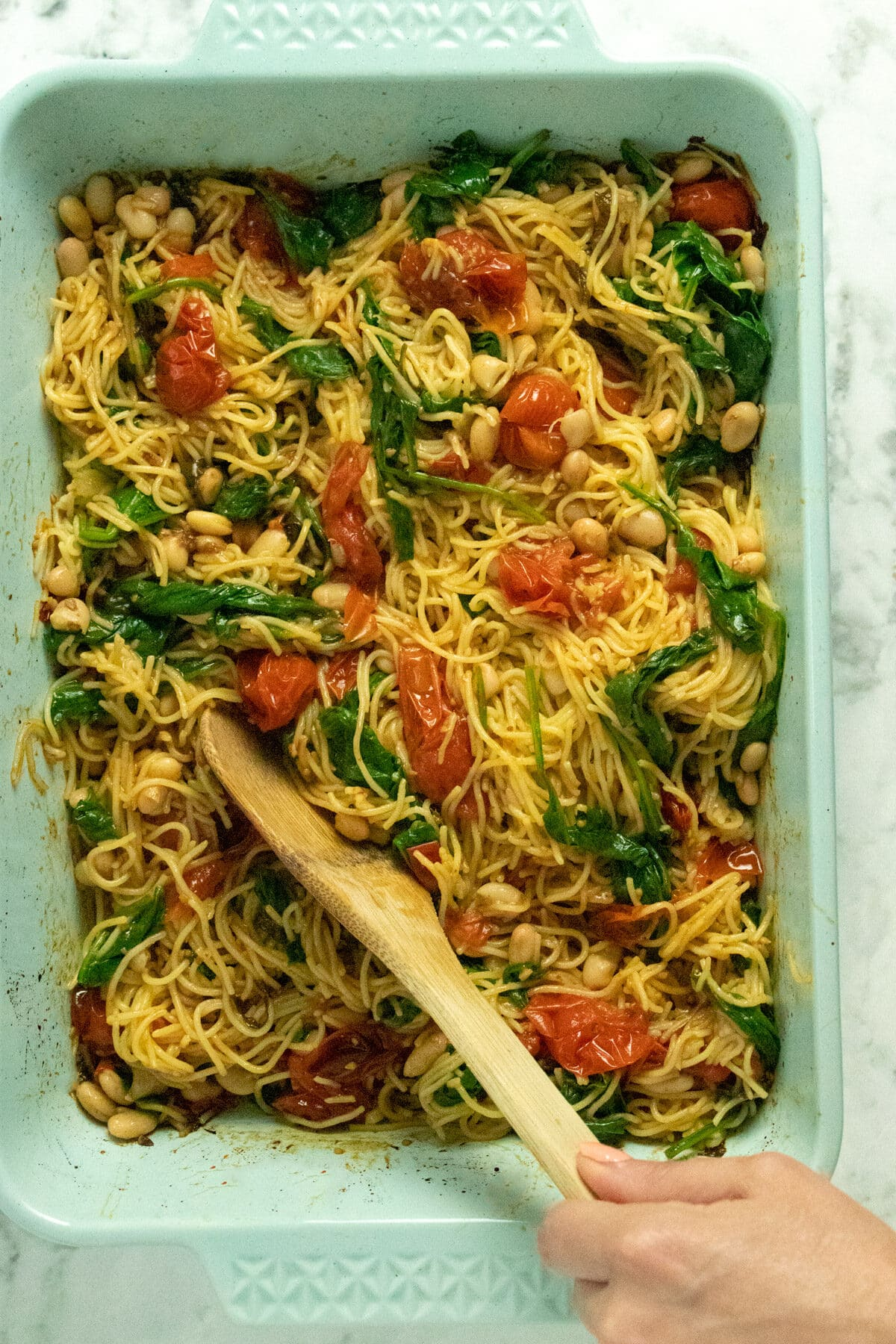 A baking pan filled with pasta and vegetables