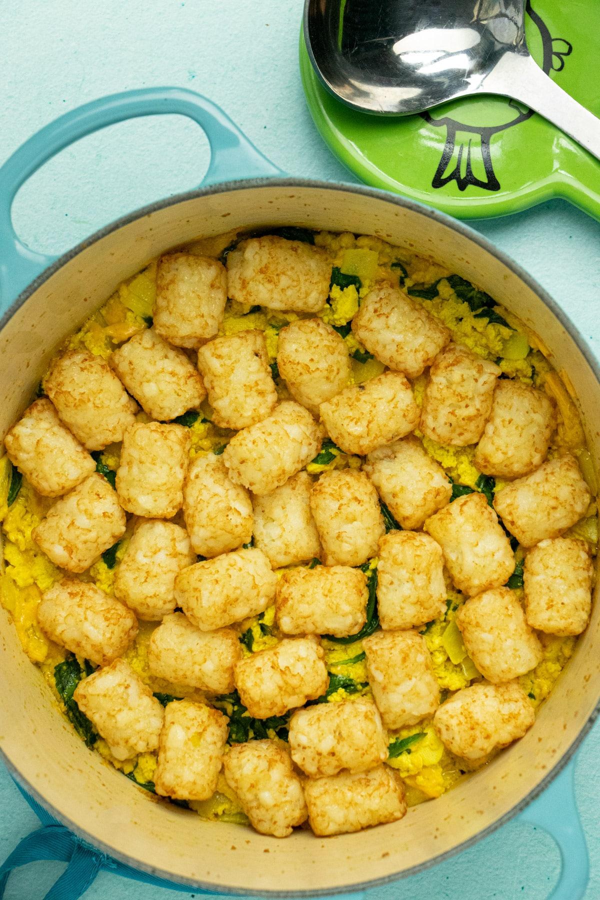 tofu scramble breakfast casserole with tater tots in a Dutch oven