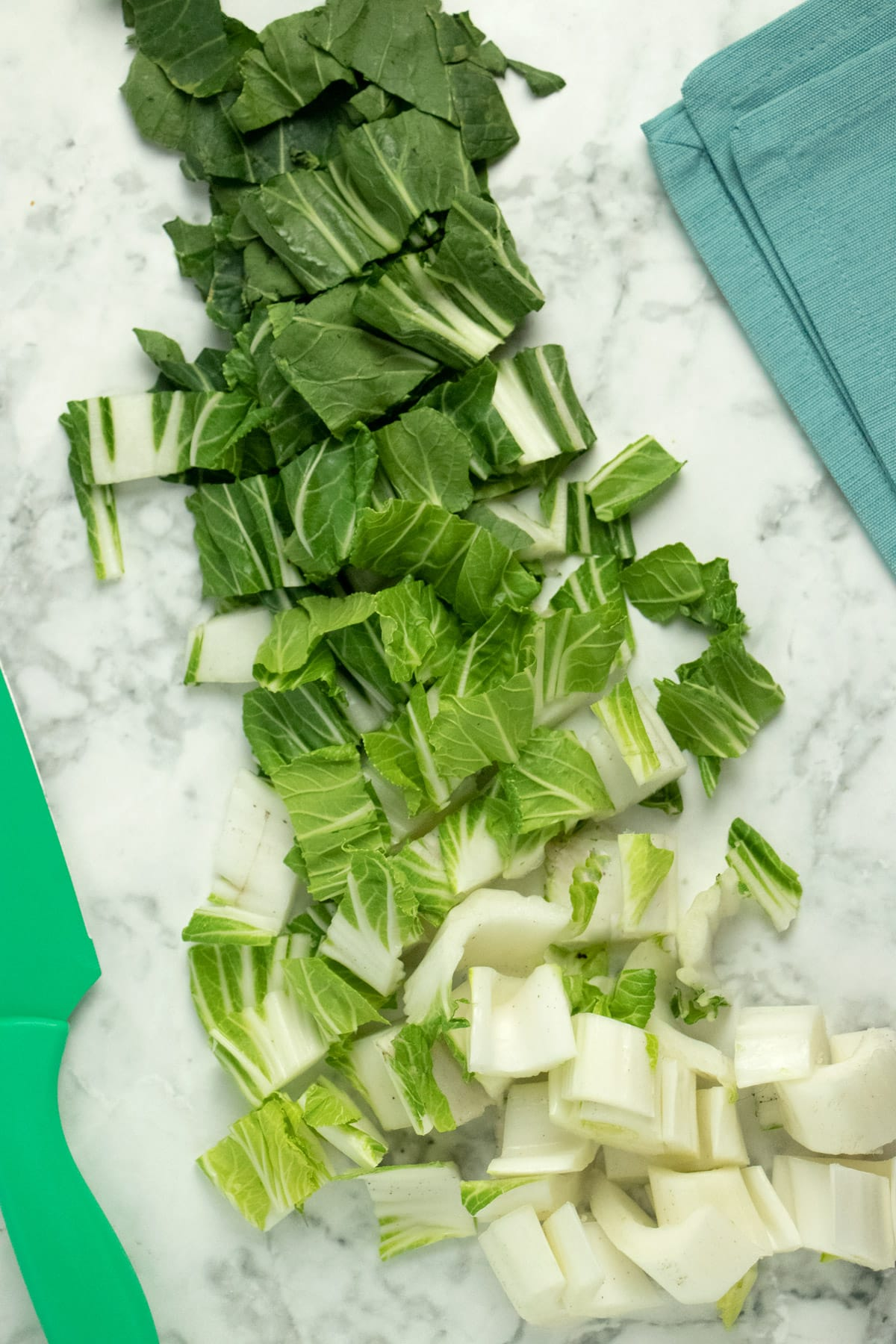 photo of chopped bok choy on a marble countertop