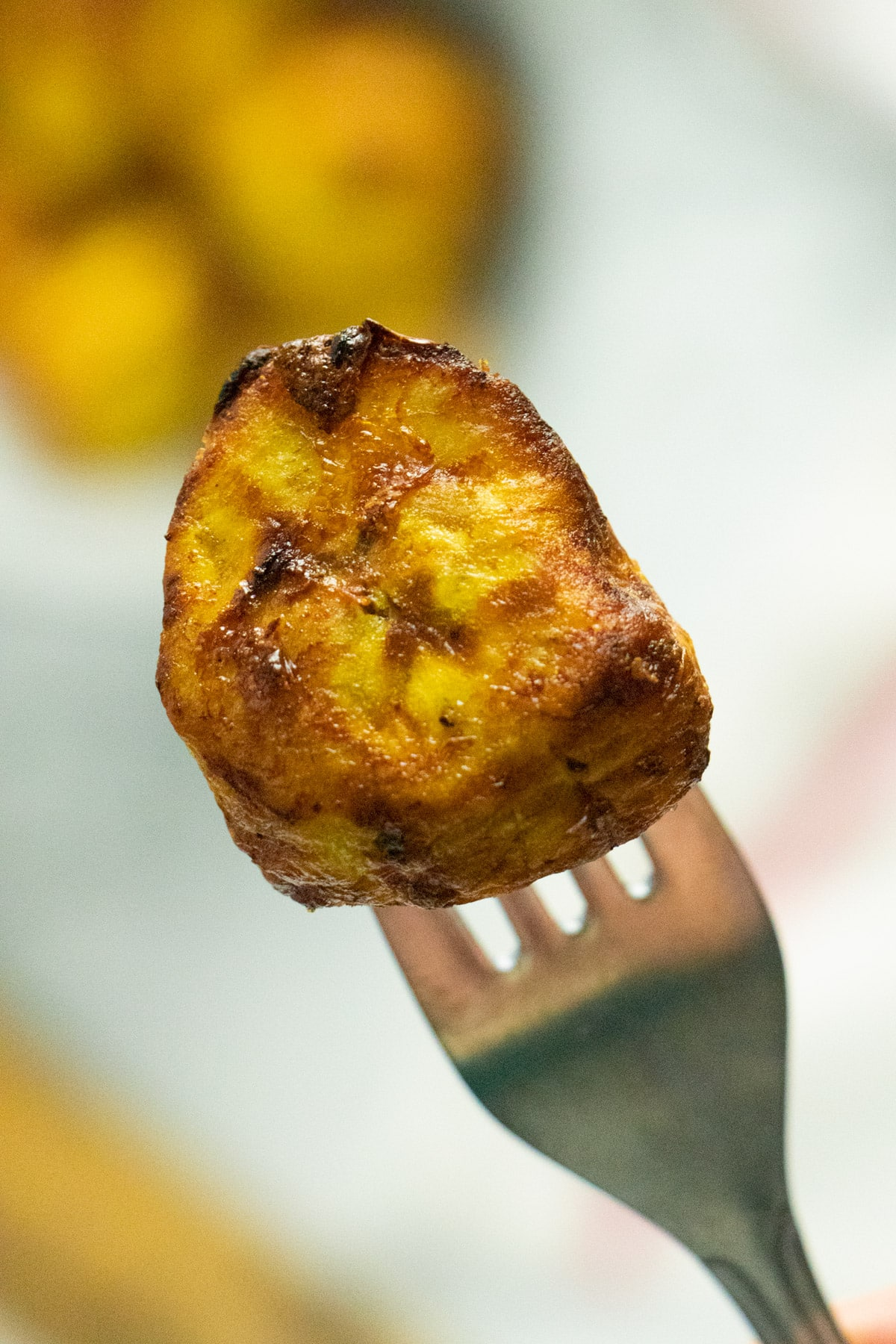 close-up of a cooked plantain on a fork