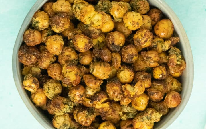bowl of ranch seasoned air fryer chickpeas on an aqua tabletop