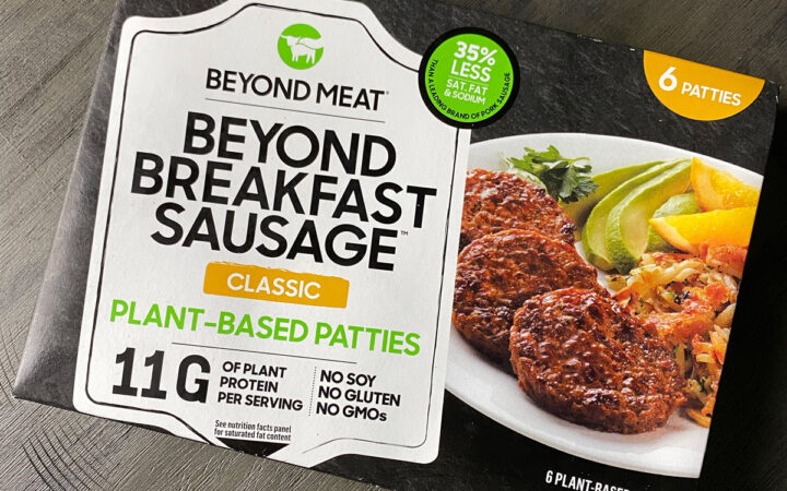overhead photo of a box of Beyond Breakfast Sausage on a gray table