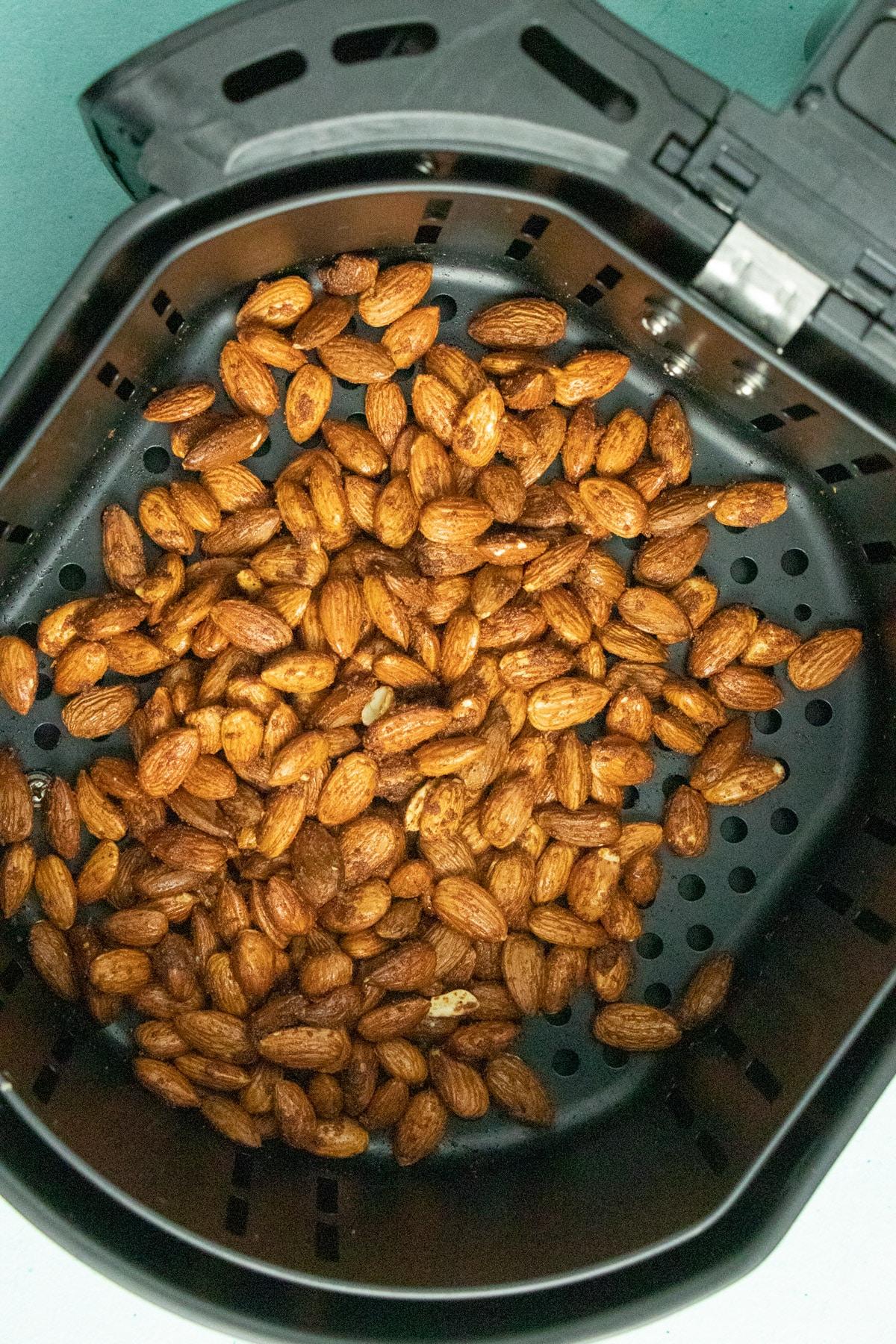 uncooked garlic almonds in the air fryer basket