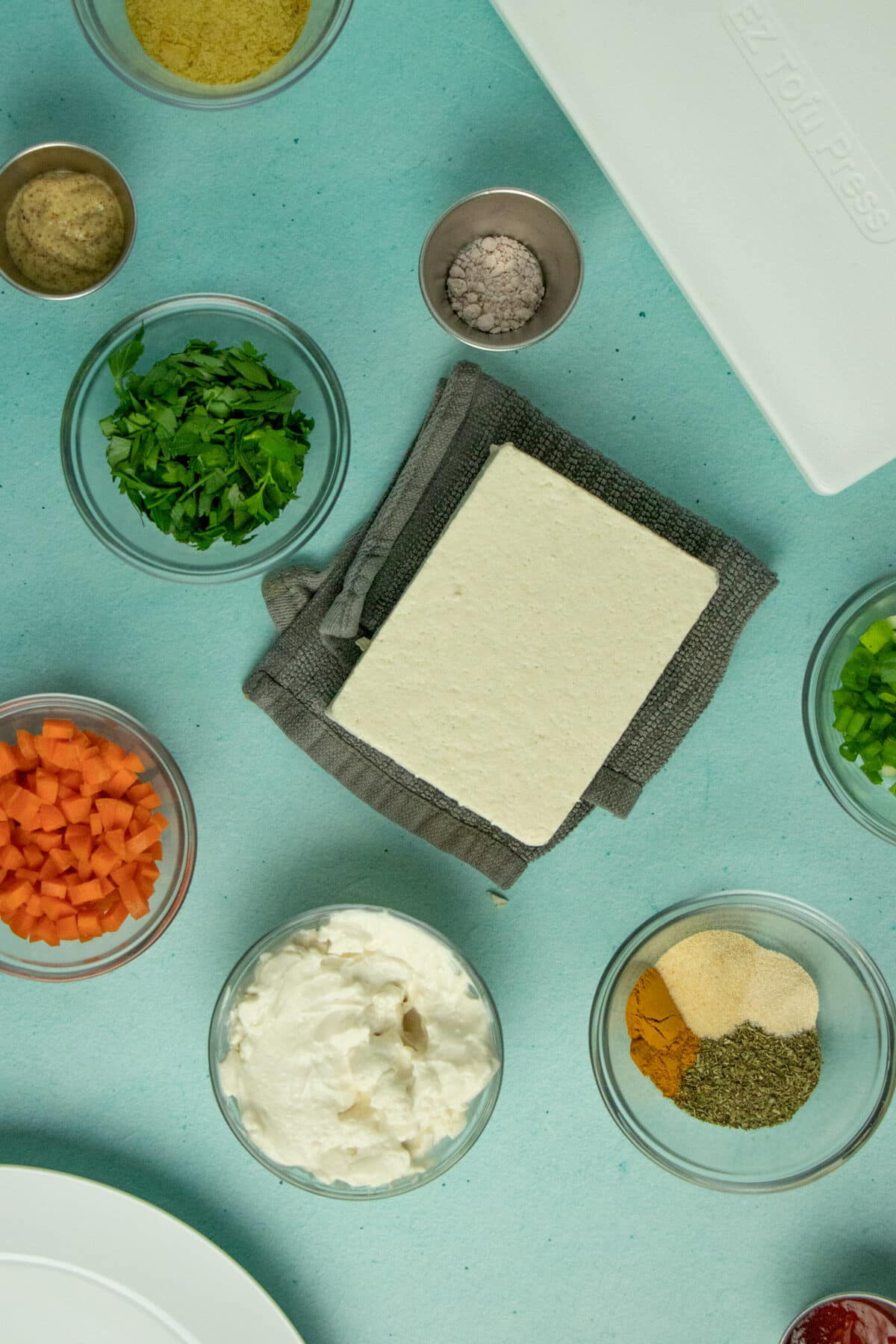 tofu salad ingredients on a blue table