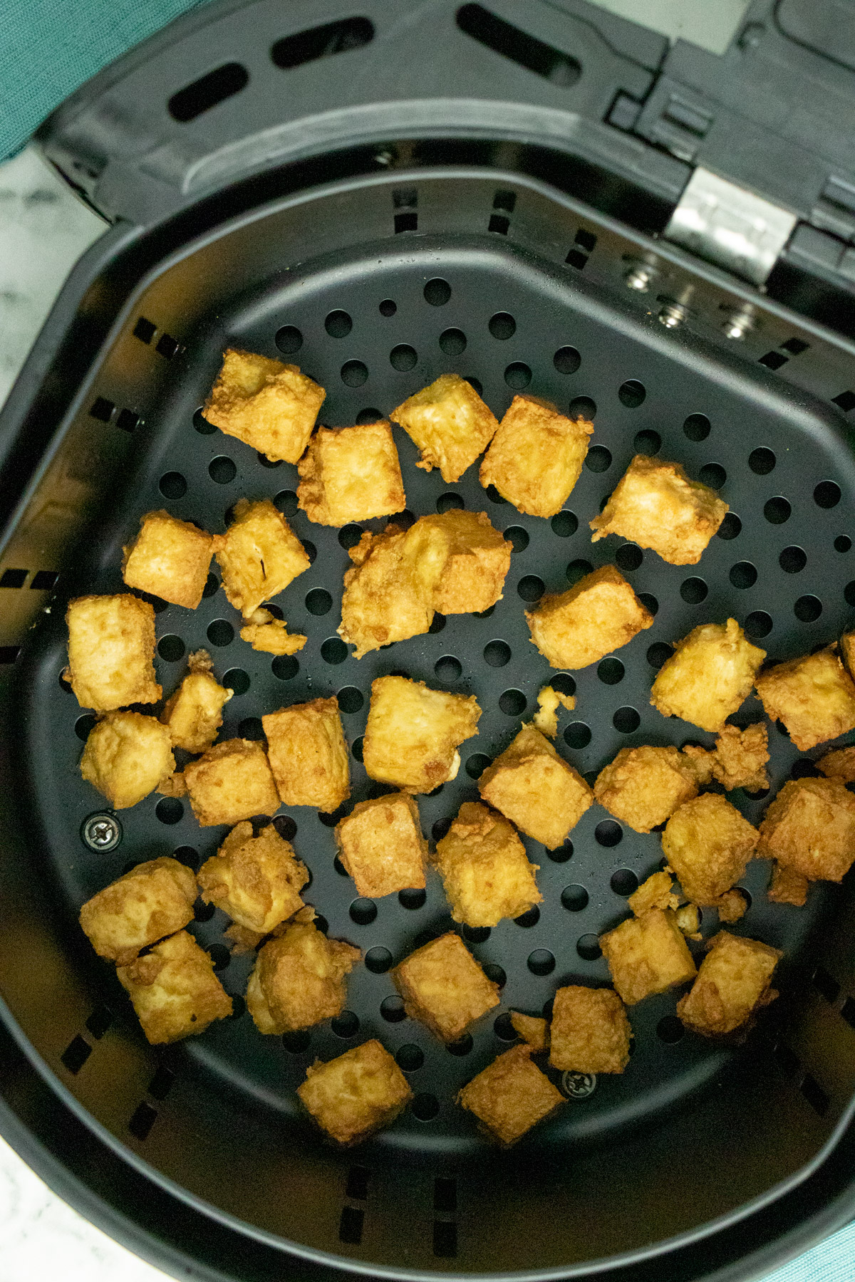 cooked tofu in the air fryer basket