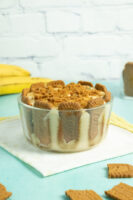 bowl of Biscoff banana pudding on a blue tabletop