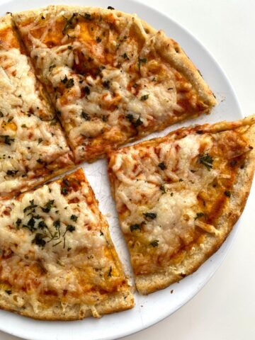 American Harvest Flatbread pizza on a white plate