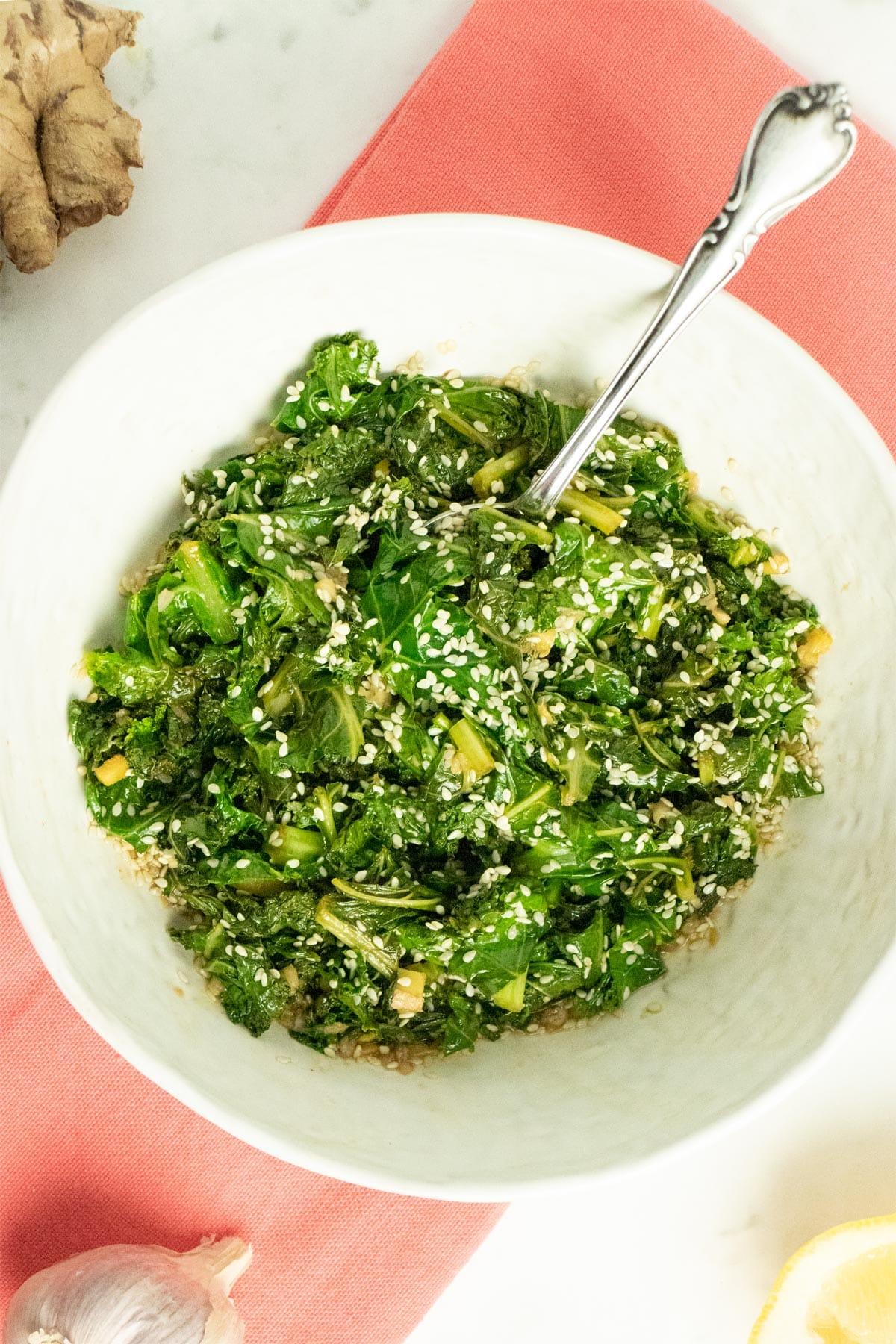 finished bowl of ginger-sesame kale stir fry on the table