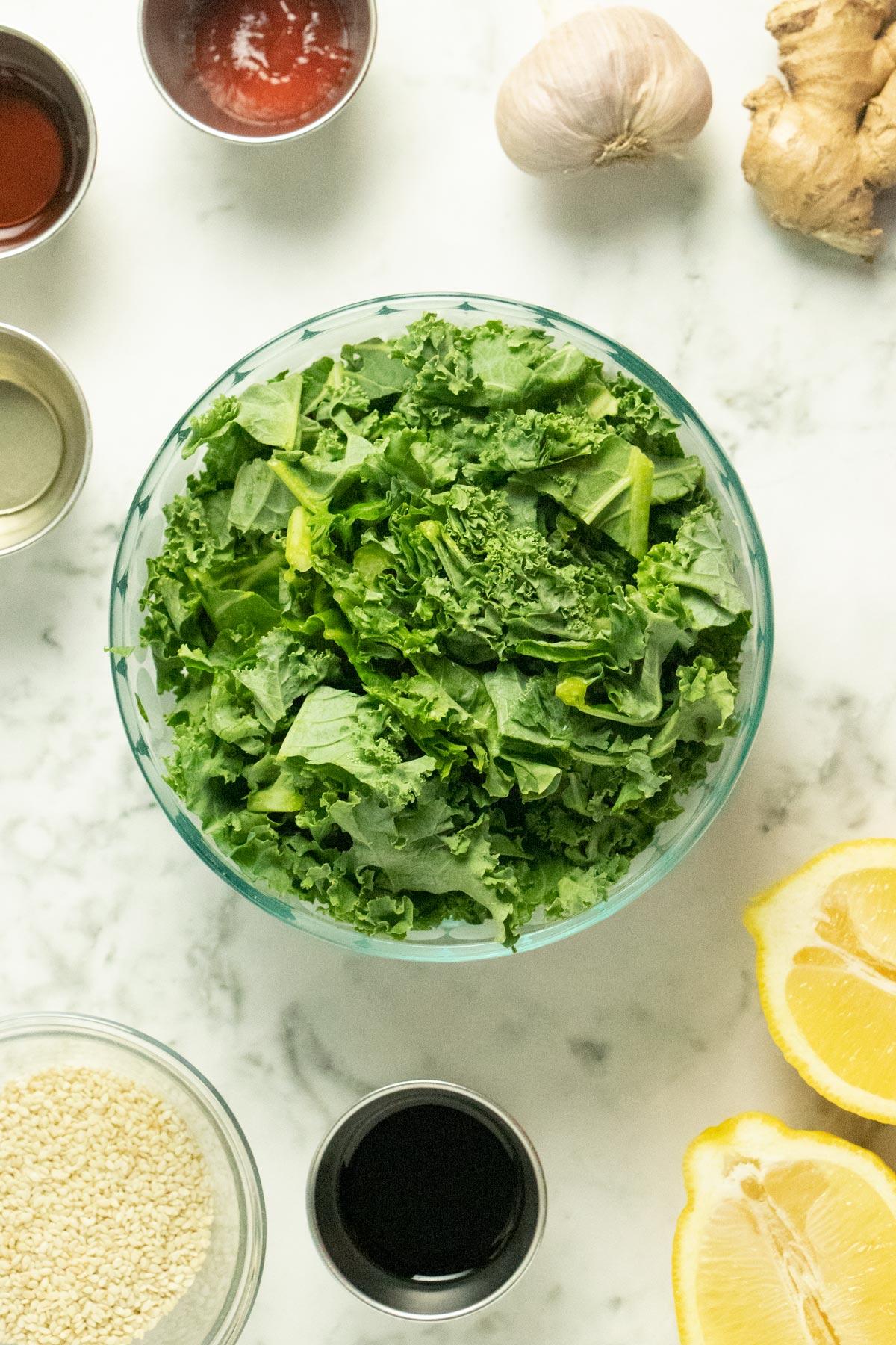 kale stir fry ingredients on a marble countertop