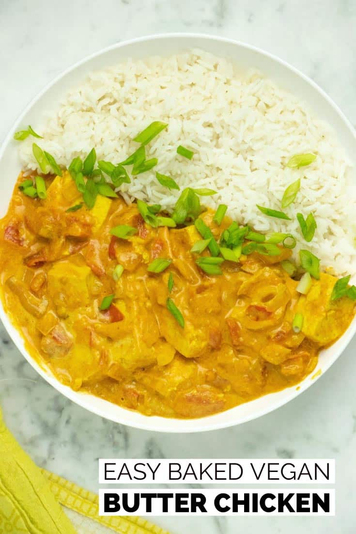 bowl of vegan butter chicken with rice and green onions
