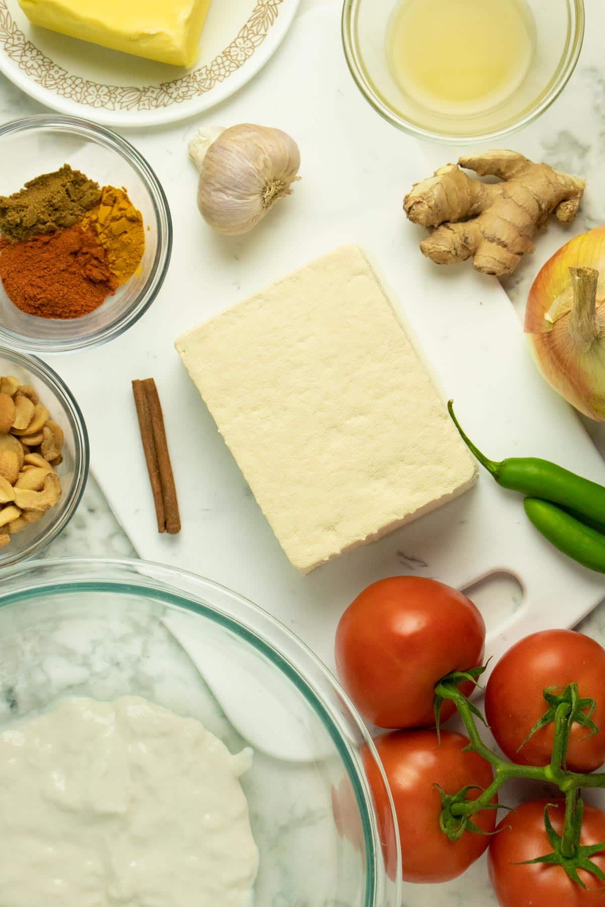 vegetarian butter chicken ingredients on a marble tabletop
