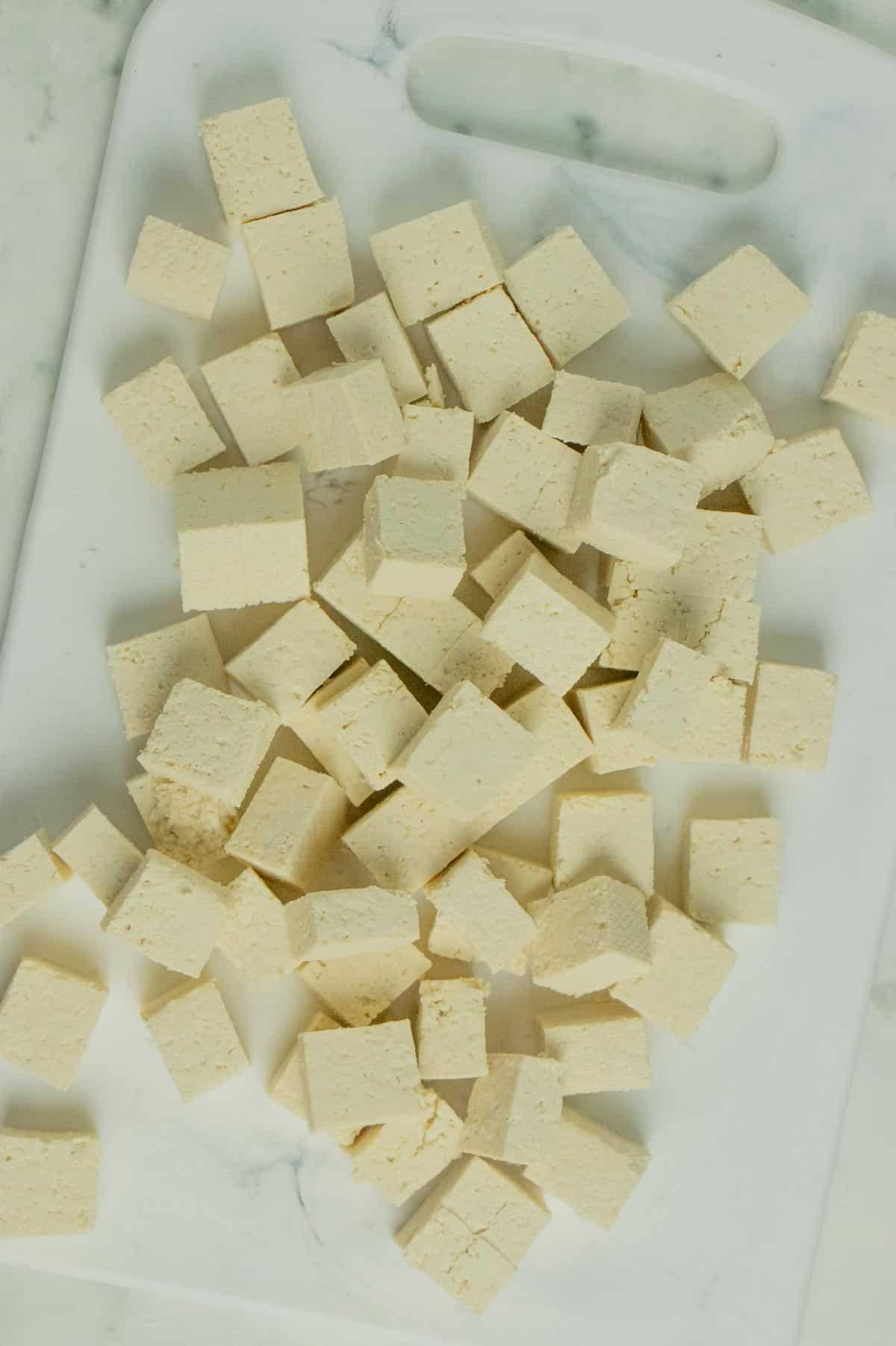 diced tofu on a cutting board