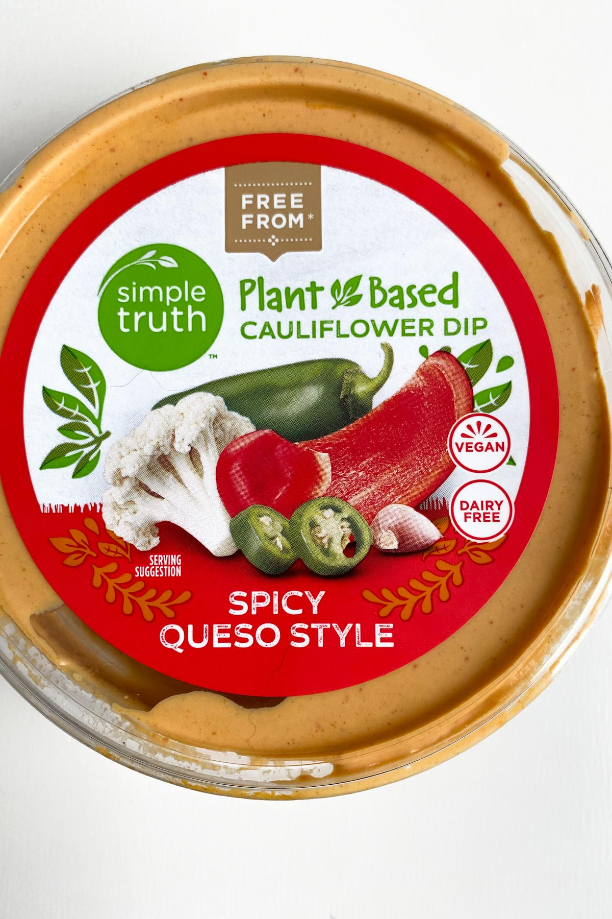 package of Simple Truth Plant Based Queso Dip on a white table